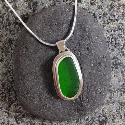 Emerald Green bezelled Guernsey sea glass & sterling silver pendant.