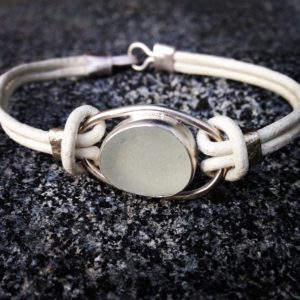 Guernsey Sea Glass bracelet bezelled with sterling silver and with a leather strap.