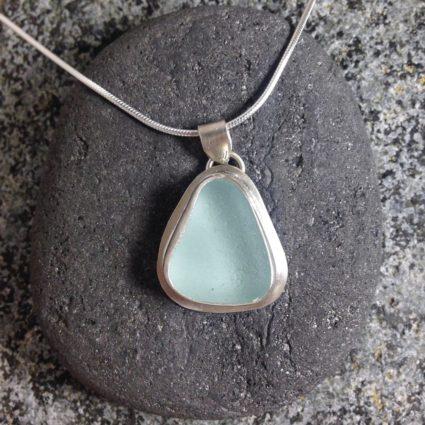 Pale Blue bezelled Guernsey sea glass & sterling silver pendant.