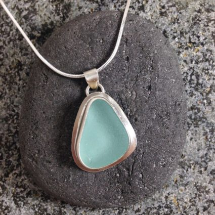 Pale Turquoise bezelled Guernsey sea glass & sterling silver pendant.