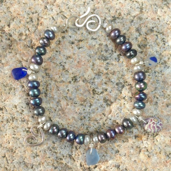 Sterling silver bracelet decorated with pearls, shells and Guernsey Sea Glass
