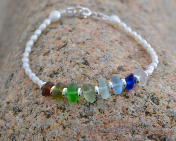 Pearl and sterling silver bracelet with a striking rainbow selection of Guernsey sea glass.