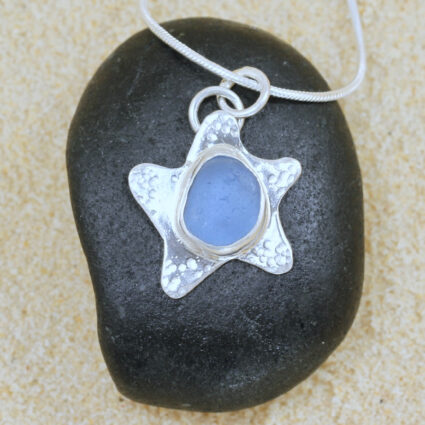 Handcrafted sterling silver starfish with pale blue Guernsey seagrass.