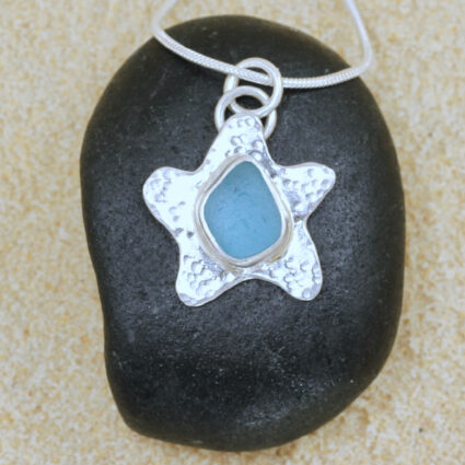 Handcrafted sterling silver starfish with pale aqua Guernsey seagrass.